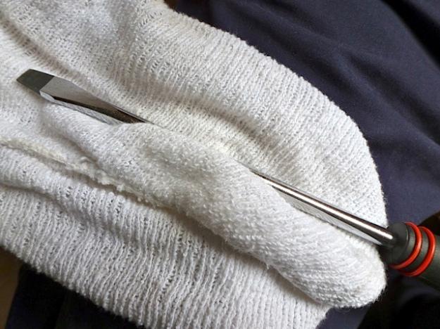 Screwdriver in dish cloth