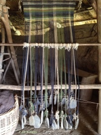 Loom showing stone weights